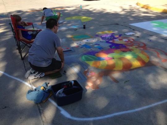 Working on RAGBRAI chalk drawing